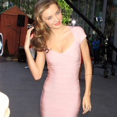 Miranda kerr bandage dress Beautiful neutral color! It is kind of like a nude with pink undertones. Almost like a blush color. Very classy color and style.  Please let me know if you have any questions and feel free to check out my other items! BCBGMaxAzria Dresses Mini