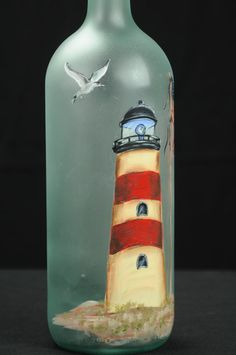 Hand Painted Lighted Wine Bottle/Lamp/ Lighthouse with Seagull and Flag - Crafts Ideas Recycled Glass Bottles, Glass Bottle Crafts, Wine Bottle Art, Painted Wine Bottles, Lighted Wine Bottles, Diy Bottle, Painted Wine Glasses, Decorated Bottles, Christmas Wine Bottles