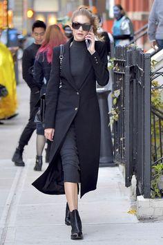 - Gigi Hadid wearing Freda Salvador Strong Chelsea Boots.