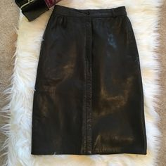 Vintage leather skirt Black Italian leather skirt with 6 buttons and two pockets. Belt loops around the skirt however one has come undone as seen in the photo, also hanger marks but other than that no other flaws. No size labels but would fit a size 2-4. Waist laying flat measures 13 inches hip area measures 17 inches and length 24 inches no trades no lowballing no questions from non serious buyers do not add to a bundle unless you intend to purchase the same day ✔️I ship the next day…