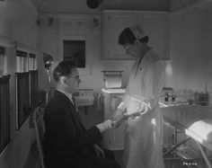 A patient receiving treatment inside the Canadian National Railways (CNR) Medical Clinic Car, 1932.  Library and Archives Canada.