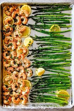 ONE PAN Roasted Lemon Butter Garlic Shrimp and Asparagus tossed with chili flakes and fresh parsley is not only bursting with flavor but on your table in 15 MINUTES! No joke! The easiest, most satisfying meal that tastes totally gourmet. Stock up on frozen shrimp and you can make this luxurious tasting meal at moment's notice. Serve the (customizable heat) spicy garlic shrimp plain or turn it into lemon garlic butter shrimp pasta!! #lemonshrimprecipes