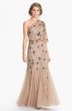 "This one is ""nude"" but I think other stores have a ""blush"" version that is slightly lighter/more flattering.  Adrianna Papell Beaded One Shoulder Gown 