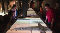 Guests look at exhibits in the Churchill War Rooms, Imperial War Museums, London