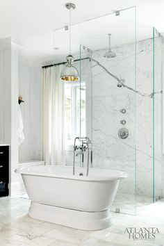 glass + marble + metal pendant in luxurious bathroom by Betty Burgess via Atlanta Homes