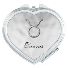 A stylish little compact mirror with Taurus birth sign in a silver color on a lovely pearly diamond white mottle design. A fabulous small gift idea for anyone born under the zodiac star sign of Taurus. #birth-signs #zodiac #birthstone-colors #horoscope-signs #silver #birth-symbol #symbols #taurus #taurus-the-bull #white #zodiac-symbols #zodiac-gift-ideas #diamond #diamond-white