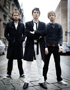 Chris Wolstenholme, Matthew Bellamy, and Dominic Howard