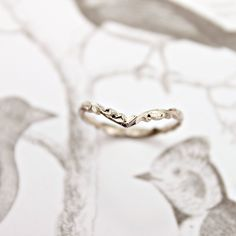 2mm width, 18ct white gold, floral carved -'Wishbone shape' ring.(shown here in size M) This ring is slightly shaped into a 'V' shape at the front. hallmarked inside the...