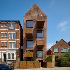 Wicker balconies project from the brick facade of this tall gabled apartment block in north London, designed by Amin Taha Architects British Architecture, Brick Architecture, Contemporary Architecture, Contemporary Apartment, Amazing Architecture, Victorian Street, Timber Structure, Brick Facade, Timber House