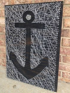 Etsy: http://www.etsy.com/listing/165064421/nail-and-string-art-custom?ref=cat_gallery_1  -  Anchor nail and string art - silver metallic string on ebony wood stained board