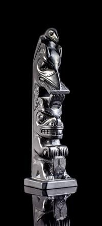 Claude Davidson, an argillite totem pole depicting Eagle, Raven, and Beaver, signed and dated 1982 to the back height: 9 1/4 in. (23.5 cm) Estimate $ 900-1,200