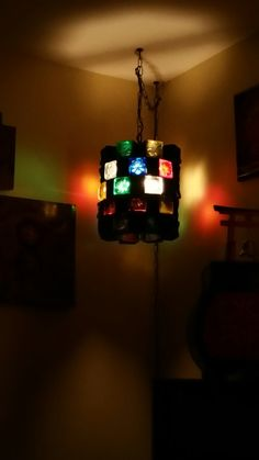 """My new mid century score black wrath iron and colored glass cube chunk swag lamp 13""""X11"""" and heavy. $20 on Craigslist"""