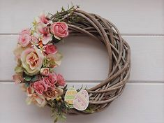 Spring on the door with flowers, greenery and Easter eggs from wood. Grapevine Wreath, Grape Vines, Easter Eggs, Greenery, Wreaths, Doors, Spring, Wall, Flowers