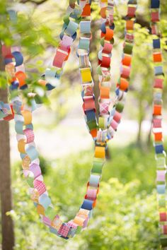 Paper chain looks pretty draped through the trees - perfect at a park party