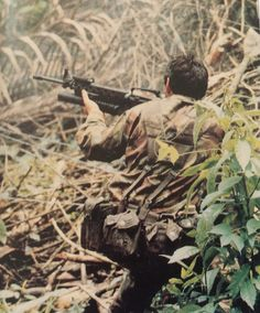 Member of B Sqn 22 SAS practicing live firing Jungle Contact drills in Malaysia (circa 1984).
