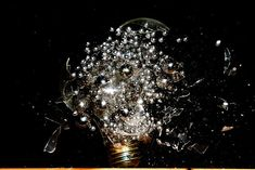 Lightbulbs filled with colorful things exploding. By photographer (and chemist!) Jon Smith.