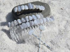 Beautiful blue lace agate stones a lovely set of hair jewelry. The matching set includes: a pair of hair combs, a french barrette, and two hair pins. The tumbled blue lace agate stones adorns a silver metal French barrette, a set of acrylic hair combs, and two metal bobby pins,. The matching set of hair jewelry is perfect for a recital, wedding or special occasion or they can be simply enjoyed with casual wear. The hair jewelry is handmade; each stone was carefully selected for its color to… Blue Lace Agate, Tumbled Stones, Stone Names, Hair Combs, Minerals And Gemstones, Matching Set, Agate Stone, Recital, Barrette