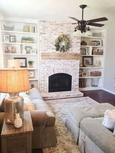 Built-in shelving bordering white washed brick fireplace. Cool 38 Amazing Modern Farmhouse Home Decor Ideas