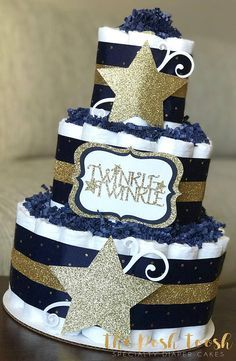 The Posh Toosh Specialty Diaper Cakes make perfect baby shower centerpieces and décor, baby shower gifts, nursery décor, and a unique and practical gift for a mommy-to-be! 3 Tier Twinkle Twinkle Little Star Diaper Cake in Navy and Gold Baby Shower Cakes For Boys, Baby Boy Cakes, Star Baby Showers, Baby Shower Diapers, Baby Shower Favors, Baby Shower Themes, Baby Boy Shower, Baby Shower Gifts, Shower Ideas