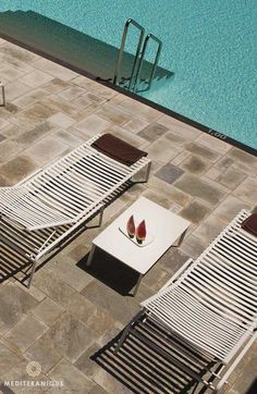 Greece Travel Inspiration - Sunloungers by the swimming pool at the Anemi Hotel in Folegandros, Greece