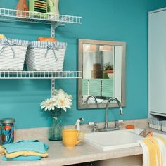 Spruce Up Your Laundry Room.....instead of painting the washer and dryer this color, I'll just use it on the walls instead....