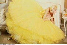 German ÜberModel Nadja Auermann is a yellow swan for Harper's Bazaar