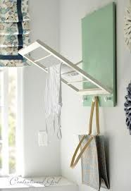 DIY project - hanging rack mounted on wall. Maybe find an old window pane and remove glass