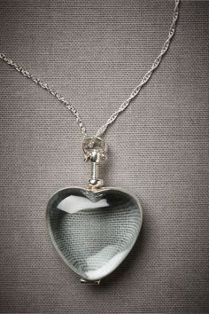 Self-Evident Necklace. Clear glass heart locket will be visible to all, whether it's a few tiny flowers, dandelion seeds, or a lock of hair.
