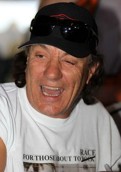 Brian Johnson Photos - Brian Johnson of AC/DC and driver of the DP BMW Riley, signs autographs before the start of during the Rolex 24 at Daytona International Speedway on January 2012 in Daytona Beach, Florida. - Rolex 24 At Daytona Brian Johnson Acdc, Music Production Companies, Ac Dc Rock, Bon Scott, Angus Young, Rock Legends, Blues Rock, No One Loves Me, Music Bands