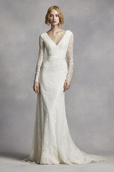 Stunningly chic, this beaded lace column gown is THE ONE for a classic bridal look! Lace column gown features all over beaded lace applique detail. Illusion long sleeve bodice features an alluring v