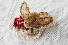 Gold embroidered brooch Eve Anders