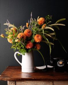 I love casual arrangements that look like they just came out of your garden. And many of mine do. I'll mix grasses, flowers, leaves.