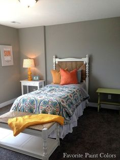Whole house in Dorian Gray from Sherwin Williams. Colors pop against this back drop of gray