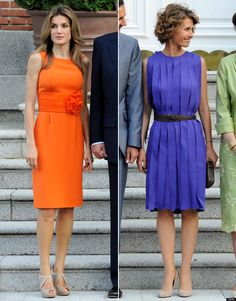 Syria's first couple paid a visit to Madrid on Sunday.resulting in a fashion face-off! Princess Letizia opted for an orange dress with a flower at the . Royal Fashion, Timeless Fashion, Blue Dresses, Dresses For Work, Fashion Face, Womens Fashion, Queen Letizia, Orange Dress, Pencil Dress