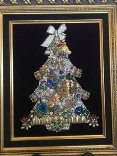 This is a one-of-a-kind Teddy Tree, signed and numbered. My grandmother, whos nickname was Teddy, made these for family, and Im carrying on the tradition making them for you. Vintage jewelry has been carefully selected for this tree. The wooden tree is covered with vintage,