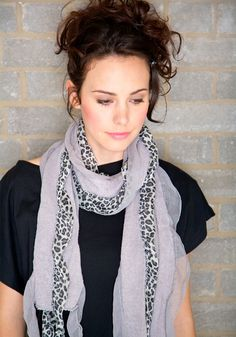 Show your wild side with our animal print ruffle scarf.
