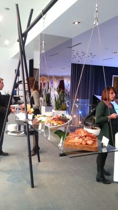Innovative coffeebreak / appetizer station featuring metal structure and suspended glass shelving, at small VIP reception hosted by the new Radisson BLU at Mall of America.