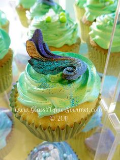 Peacock cupcake love the green and yellow together