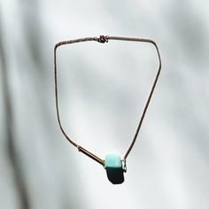 In captivating shades of turquoise-green, an Amazonite stone is hung with a bar on a rose gold-plated chain. The stone is known to soothe the spirit and calm the soul. Its energy is as powerful as the river for which it is named, and as bold as the legendary women warriors with whom it is connected. It provides harmony and balance.