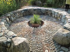 Beautiful stone firepit, at  Windcliff, Dan Hinkley's Amazing Garden In Indianola, Washington - The Martha Stewart Blog, hardscaping, outdoor patio, outdoor oasis, outdoor seating, stone, boulder, art pattern