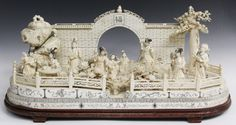 """CHINESE CARVED IVORY GOOD FORTUNE SCHOLAR GARDEN A magnificent large and very detailed carved ivory garden scene. Young scholars and beauties drinking tea and wandering about the garden. Ivory over wood floor and wall. Solid carved ivory figures, flowers, table and accent items. 9 figures measuring 3""""-5"""" each. Garden wall with Chinese symbol """"Fu"""" for """"Good Luck"""" or """"Good Fortune"""". A stream flows through the garden with ducks and large lotus flowers. Size 30 x 12.5 x 12.5"""""""