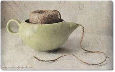 A teapot makes a dandy twine dispenser.  via freshandfun blog