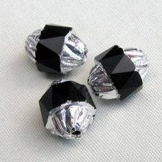 b11-bw-0653-Fire polished oval black faceted with silvered edges. Pkg of 5