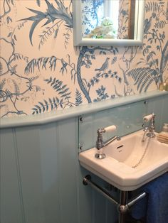 Like this idea for the downstairs cloakroom. Wood panels, glass splashback. Wallpaper