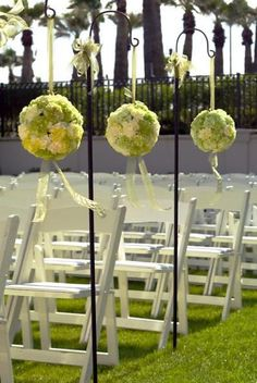 Kissing balls that line the aisle is becoming very popular. Definitely something you can use for the ceremony then bring to reception...good money saving idea!