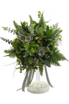 On-trend foliar bouquet by Viviano Flower Shop! Bridal design created with foliage only - gray and green palette of succulents, ferns, eucalyptus, kale, and more accented with trailing black and white striped ribbons. Stunning option for an eco-friendly modern wedding.
