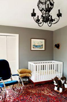Design Crisis Erin Williamson nursery, gray walls, black chandelier, blue velvet chrome rocker, Persian rug