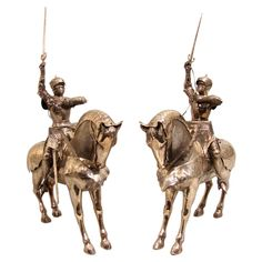 """A fine pair of silver Continental or German well-detailed armored knights on horseback in 15th century Gothic attire and armed with swords and maces. Circa 1900.    H. 20"""" W. 6"""" D. 11.5""""  $12,500.00"""