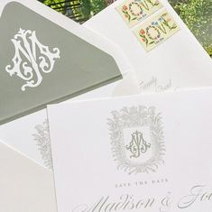 Green with envy over this beautiful Save the Date suite with our MJ monogram from our Monogram Chic Font package. ⠀ The envelope liner! The crest! And the perfect stamps! @shopsurcie brings it all together in a stunning ensemble that anyone would love to receive in the mail. . . . #weddingsuite #weddingmonogram #monogramcrest #envelopeliner #savethedate #antiqueletters #2lettermonogram #couplesmonogram #vintagemonogram #weddinginvitation #paperlove #monogrammedinvitation #southernwedding…