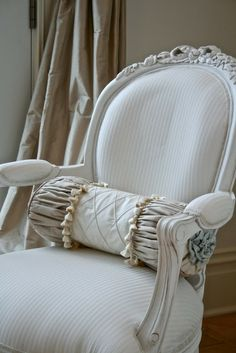 Lovely chair with pillow accent